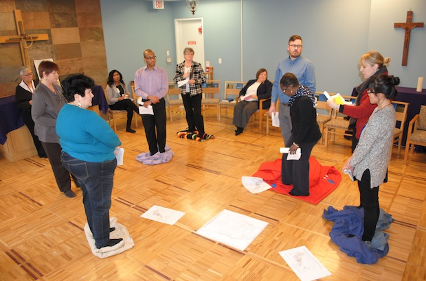 Staff at the office of General Synod take part in the Blanket Exercise, a teaching tool in Indigenous Canadian history, at the Chapel of the Holy Apostles February 17. Photo: Tali Folkins