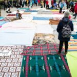 Photo: In the blanket exercise, blankets represent land belonging to Indigenous people prior to contact. As the game goes on, the blankets become smaller, with large distances between them.
