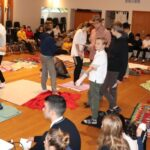 Island Pacific School students participate in the KAIROS Blanket Exercise. Photo by ISLAND PACIFIC SCHOOL