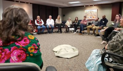 Participants sitting in a circle during an exercise