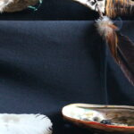 smudge bowl burning under a talking stick copyright Kiniw Studio