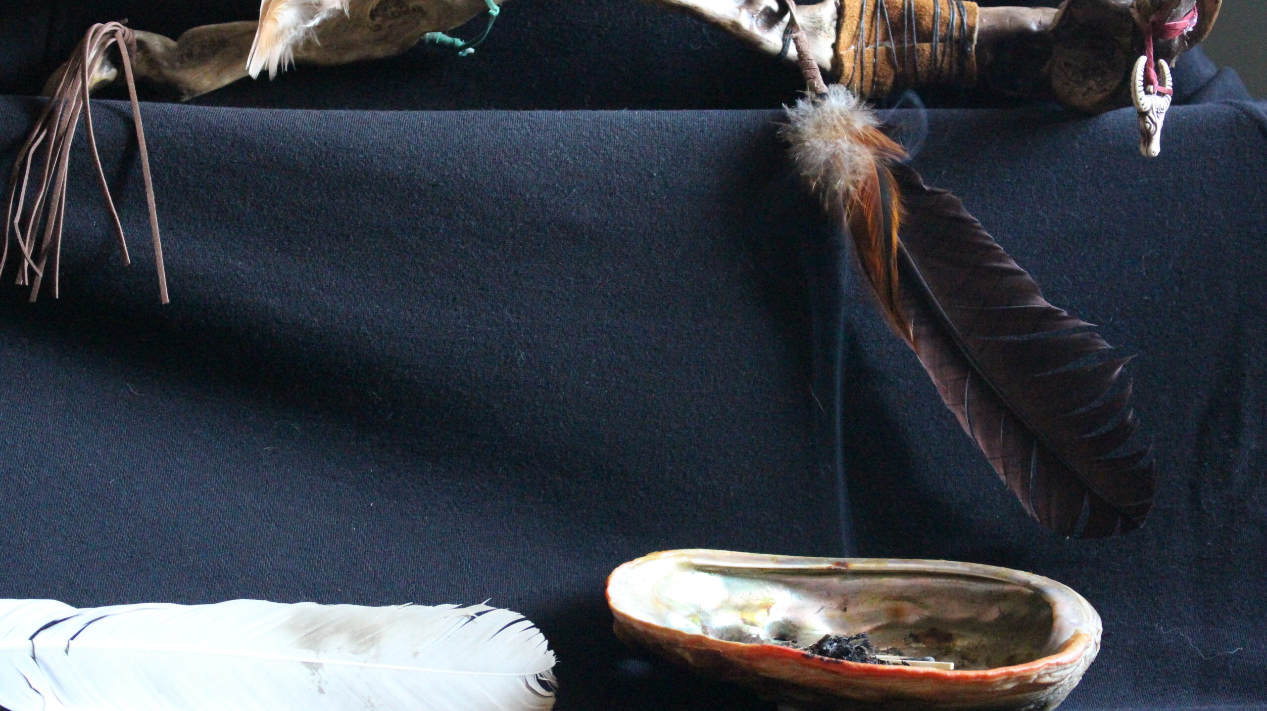 smudge bowl burning under a talking stick copyright Kiniw Studio