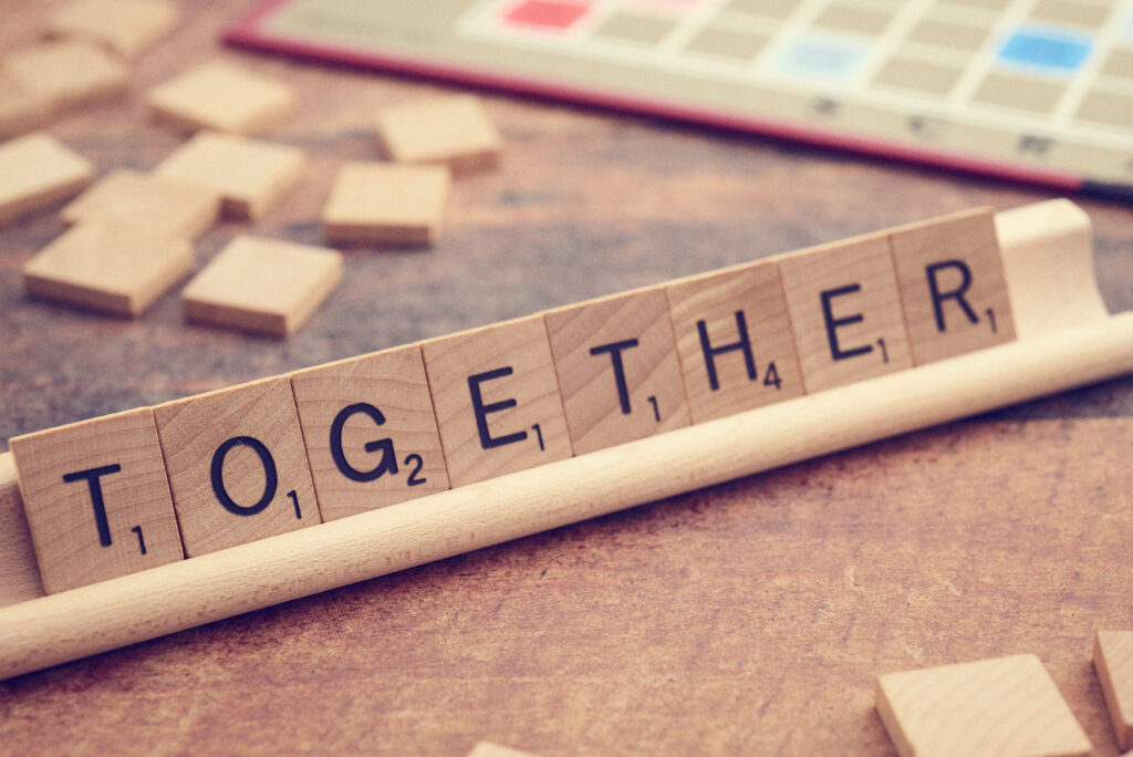 """scrabble tiles spell the word """"together"""""""