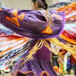A dancer spins at a pow wow held at the University of Toronto on March 11, 2017. (Credit: Hannah James)